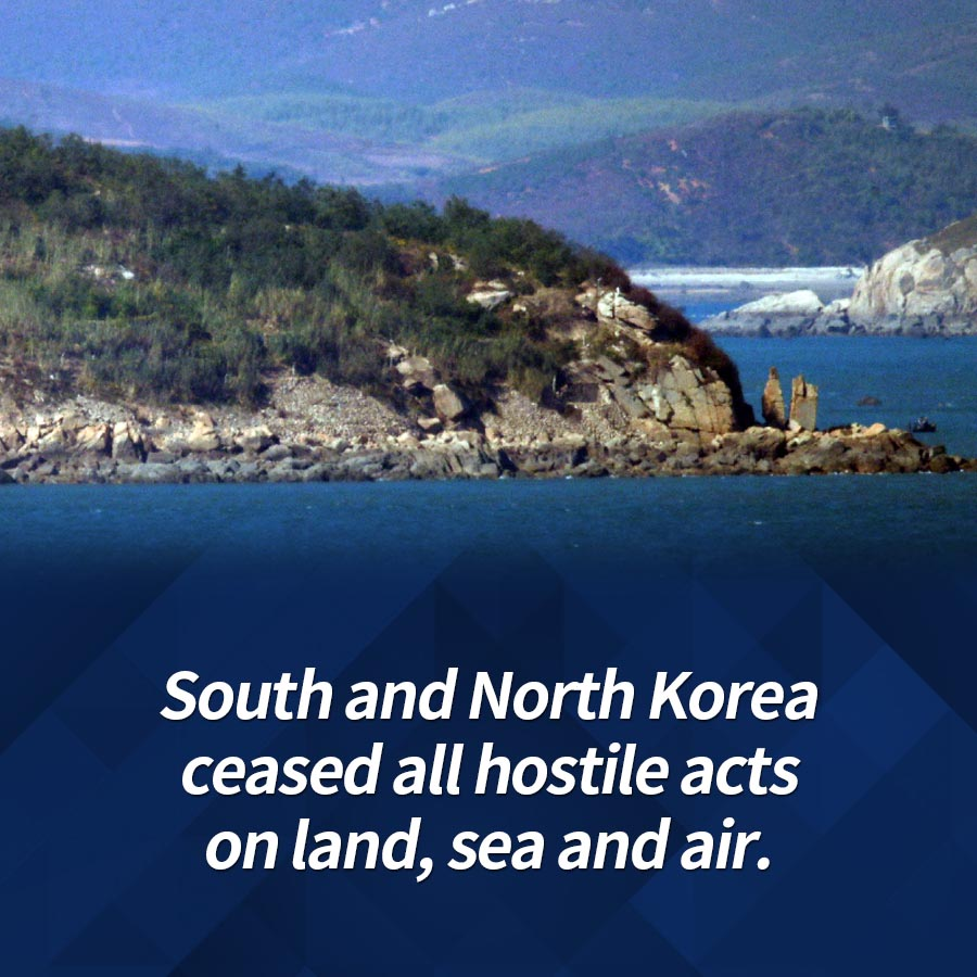 South and North Korea ceased all hostile acts on land, sea and air.