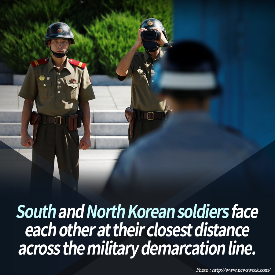 South and North Korean soldiers face each other at their closest distance across the military demarcation line.